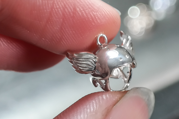 Silver tiny winged crash helmet