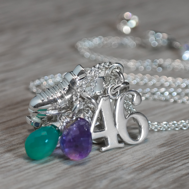 Sterling silver roller derby necklace with number and gemstones