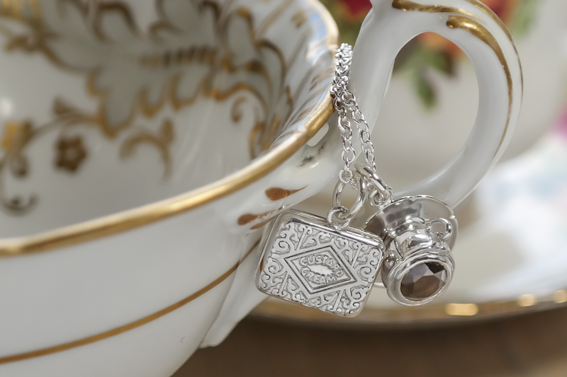 Silver custard cream tea and biscuits necklace