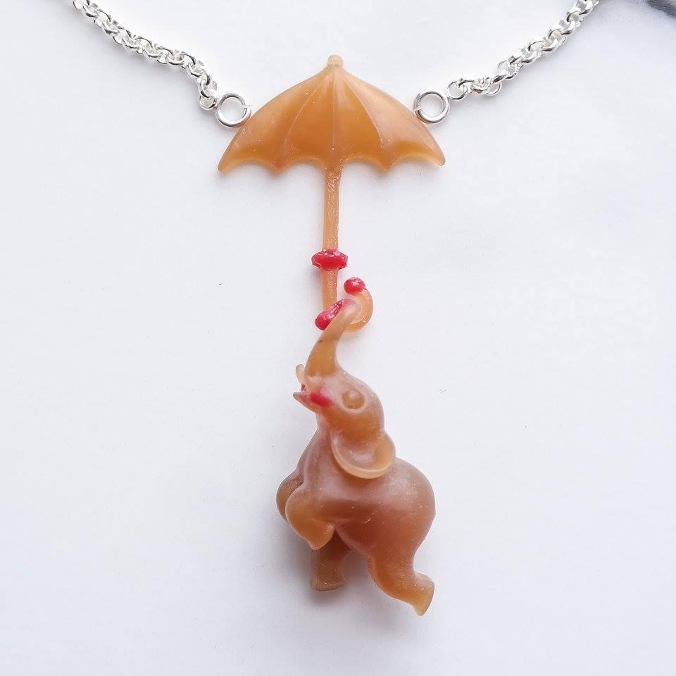 Elephant umbrella wax carving