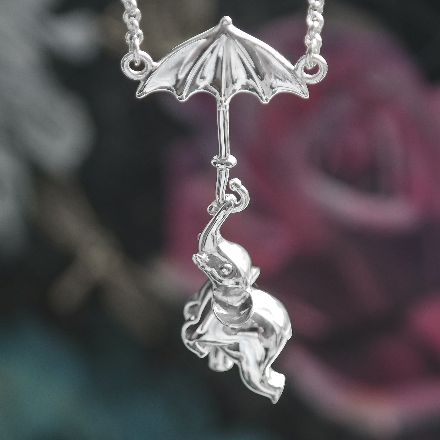 Sterling silver elephant hanging from umbrella necklace
