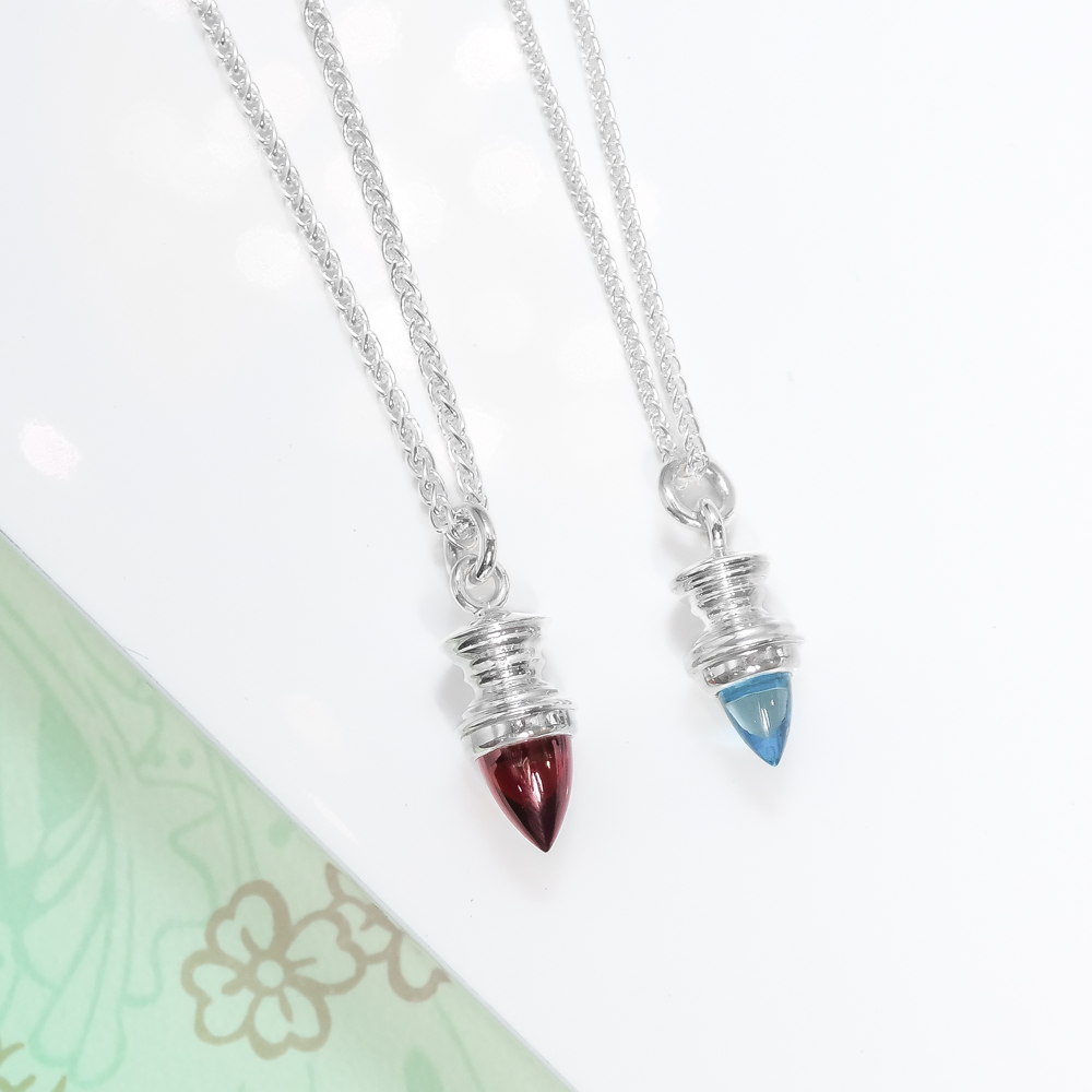 Sterling silver and garnet blue topaz bullet gemstone necklace