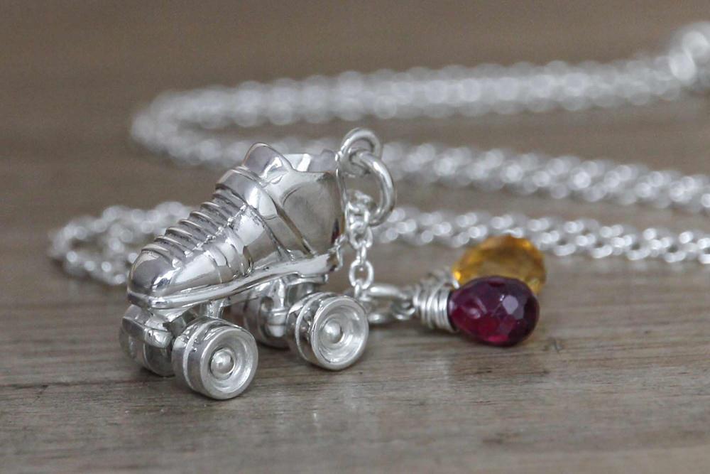 Silver custom roller derby skate necklace garnet and citrine gemstones.JPG