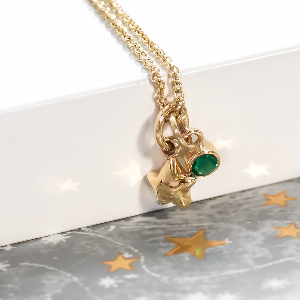 Eco-18-gold-solid-fat-star-emerald-necklace.jpg