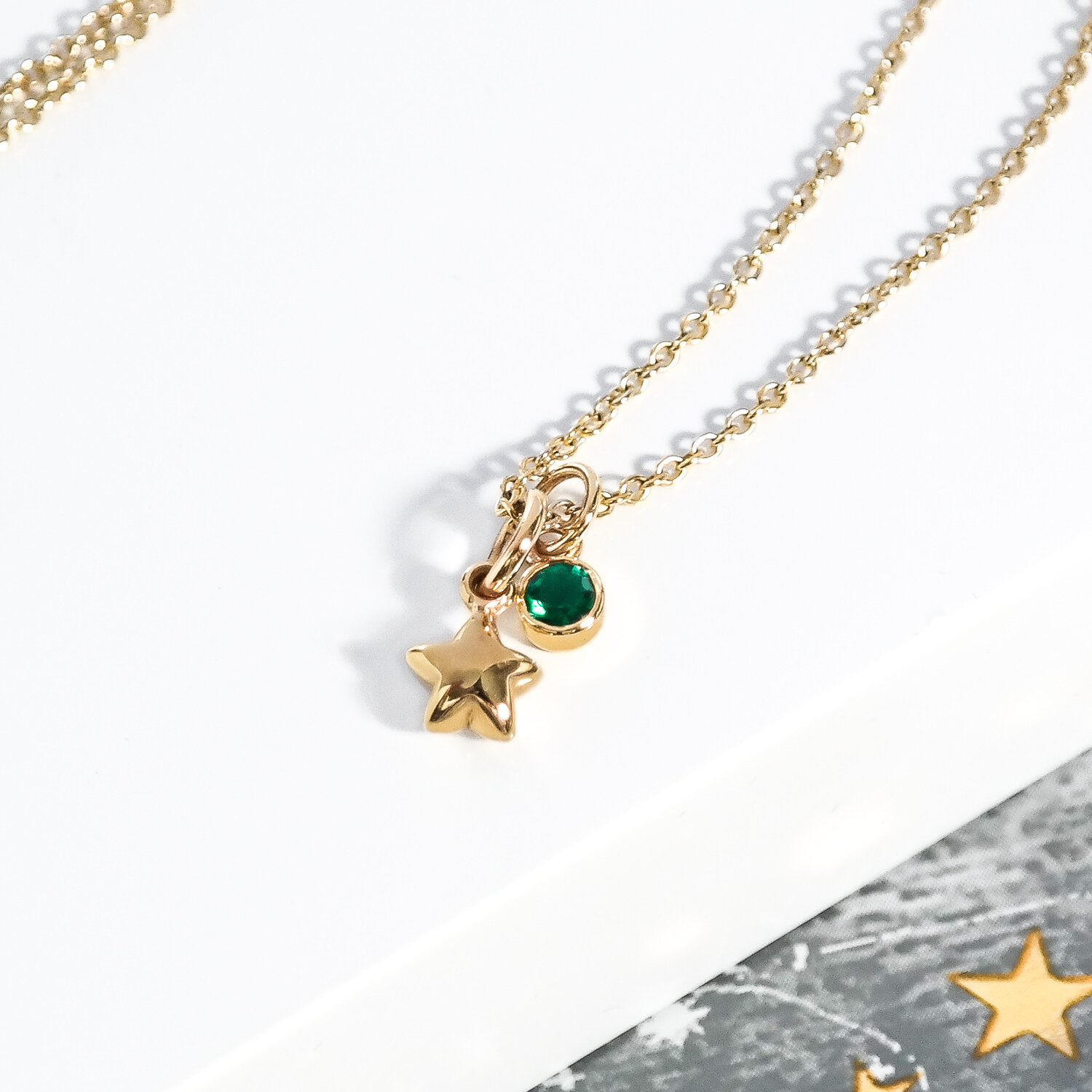 Solid-eco-recycled-gold-tiny-star-emerald-necklace-ethical.jpg
