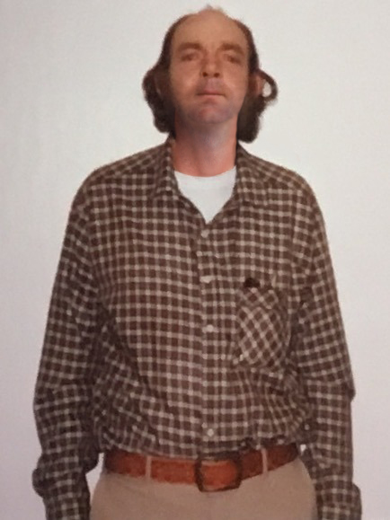 """This photo of """"Curtis Kimball"""" was taken in 1990, when he was paroled after being jailed for child abandonment."""