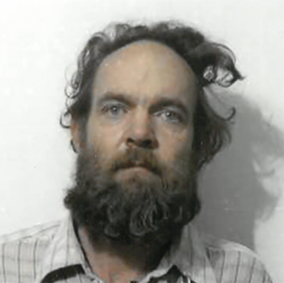Robert Evans' 1985 booking photo. He was later convicted for child abandonment.