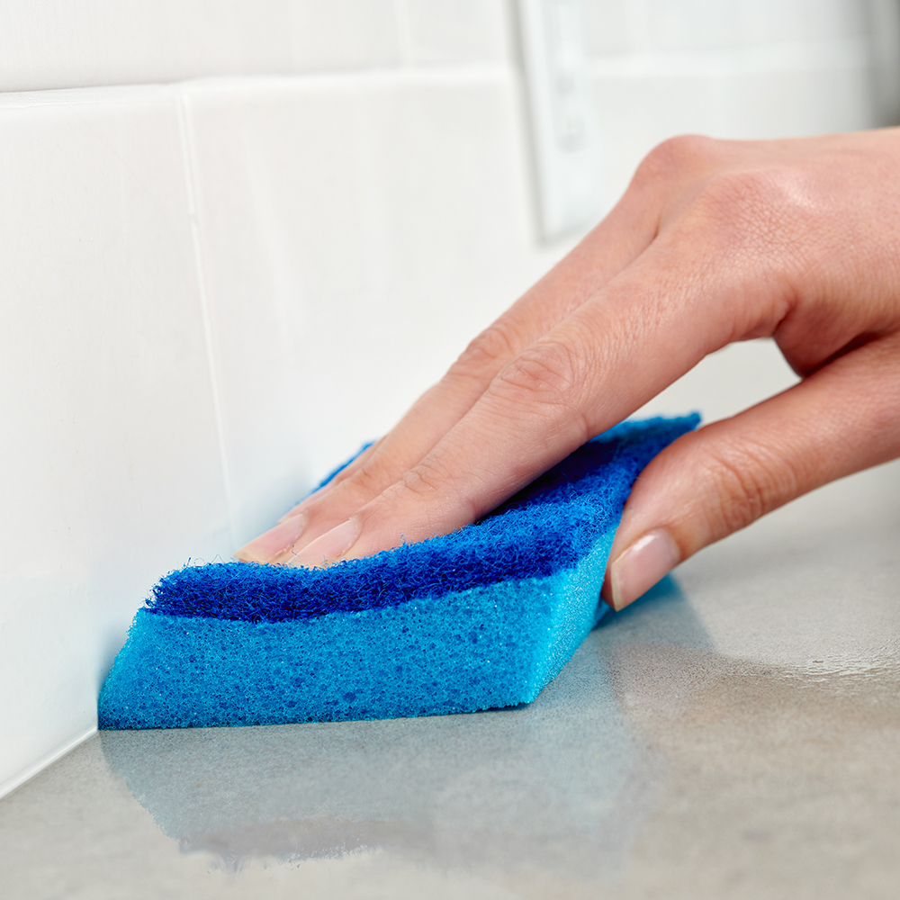 Brillo® Estracell® No Scratch Scrub Sponge with Wedge Edge cleaning a counter
