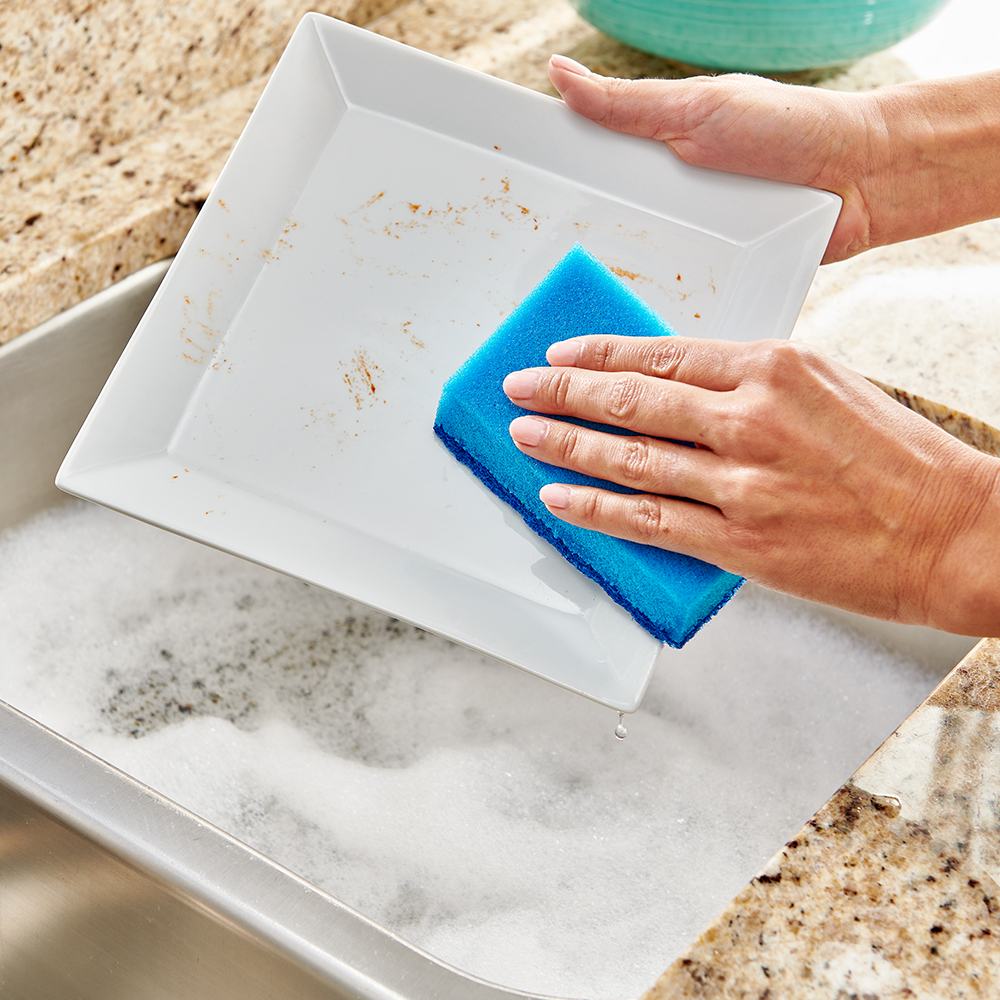 Brillo® Estracell® No Scratch Scrub Sponge with Wedge Edge cleaning a plate