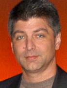SPIKE MANTON, Development Director