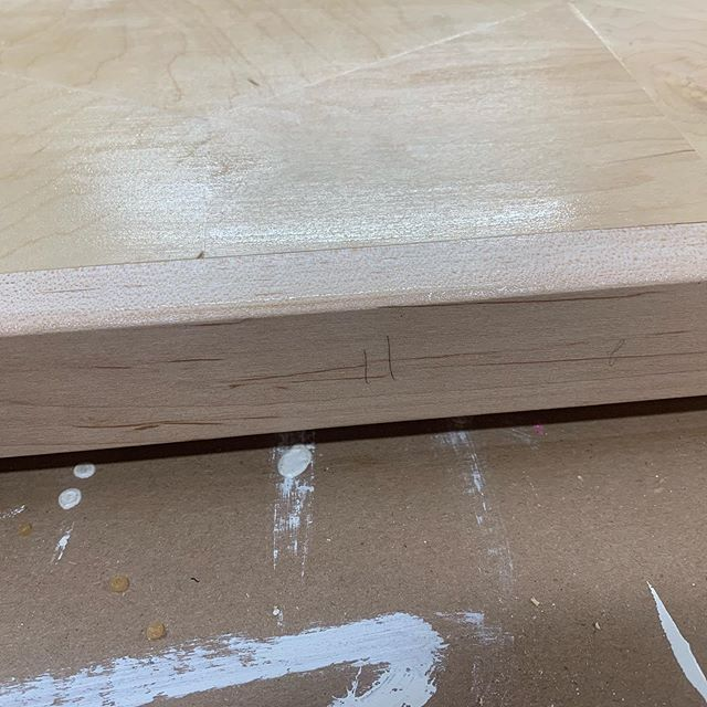 Almost done with the second coat of finish and noticed I did a horrible job of sanding one edge...my part numbers are still on there.  #oops #sanding #sandintheplacewhereyoulive #woodworking #wood #woodshoplife #maker #diy #diyhomedecor #coffeetable #livingroomdecor