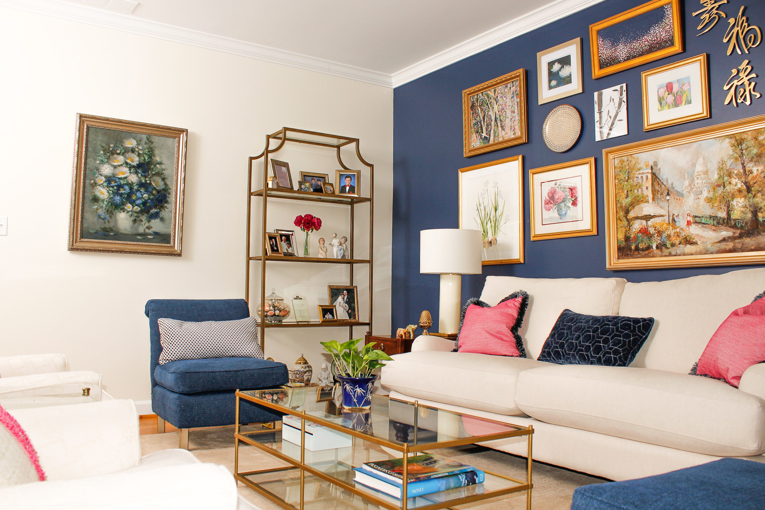 Family photos are displayed on the gold etagere.