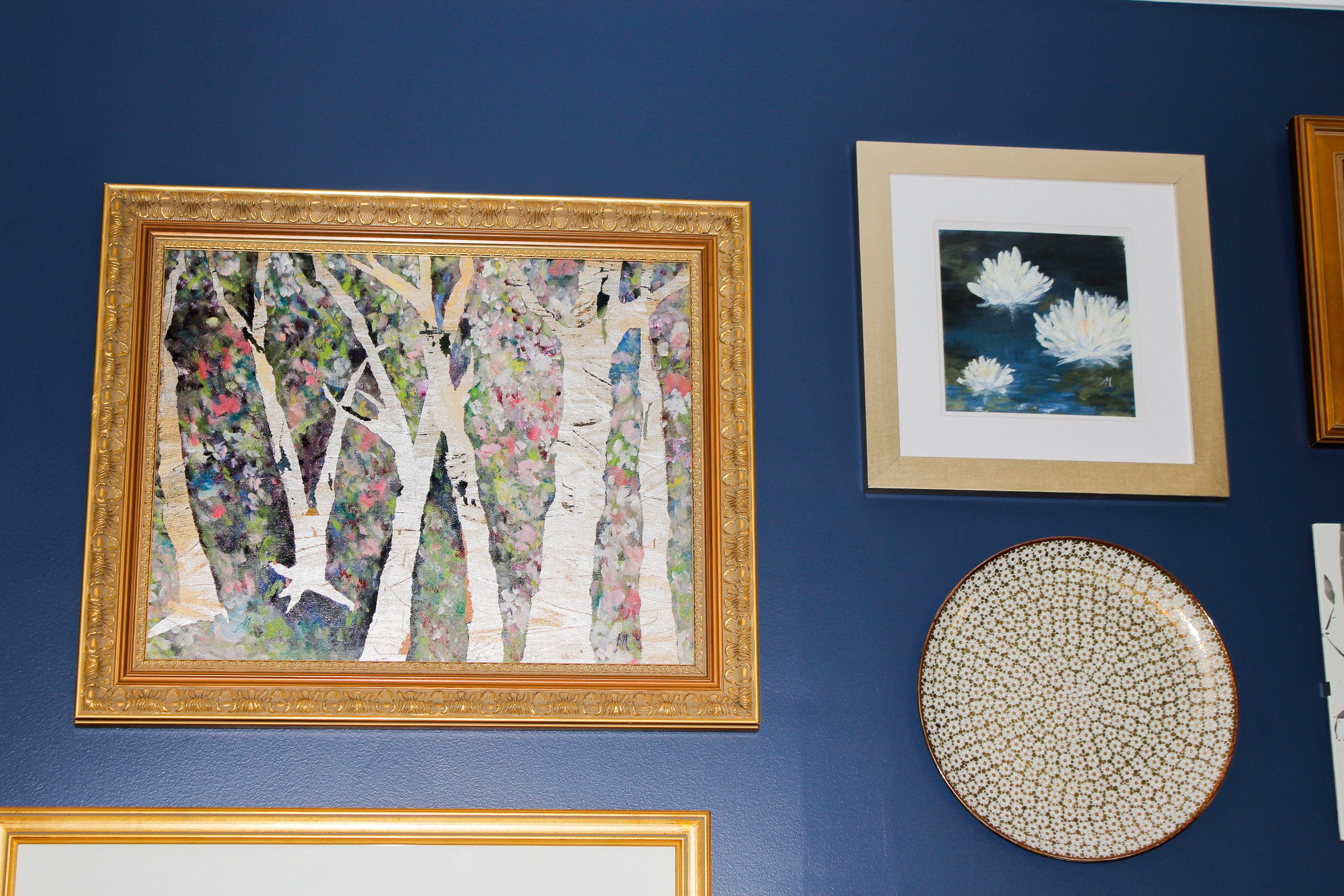 Five original pieces of artwork by Michele Araquette were included in the gallery wall.