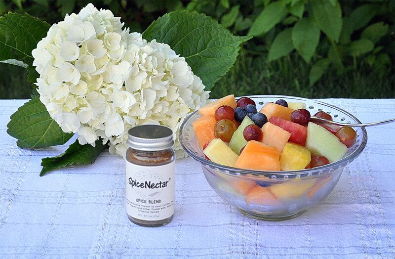 sprinkle SpiceNectar over fruits in a bowl