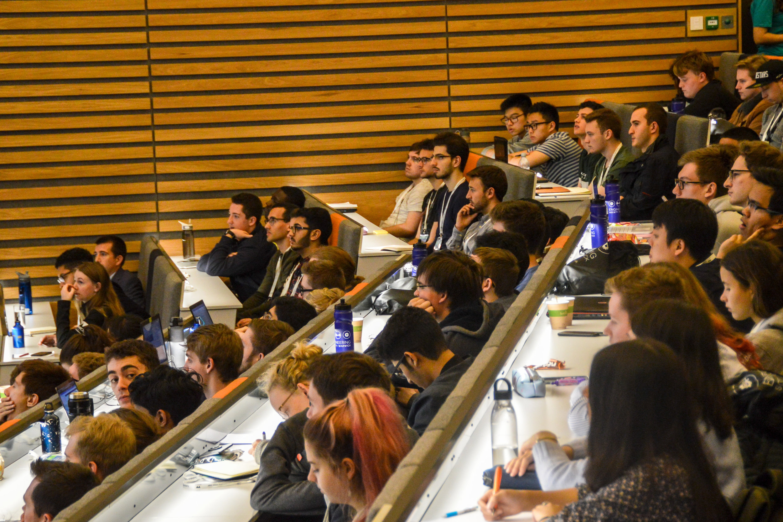 Delegates watch the panel session