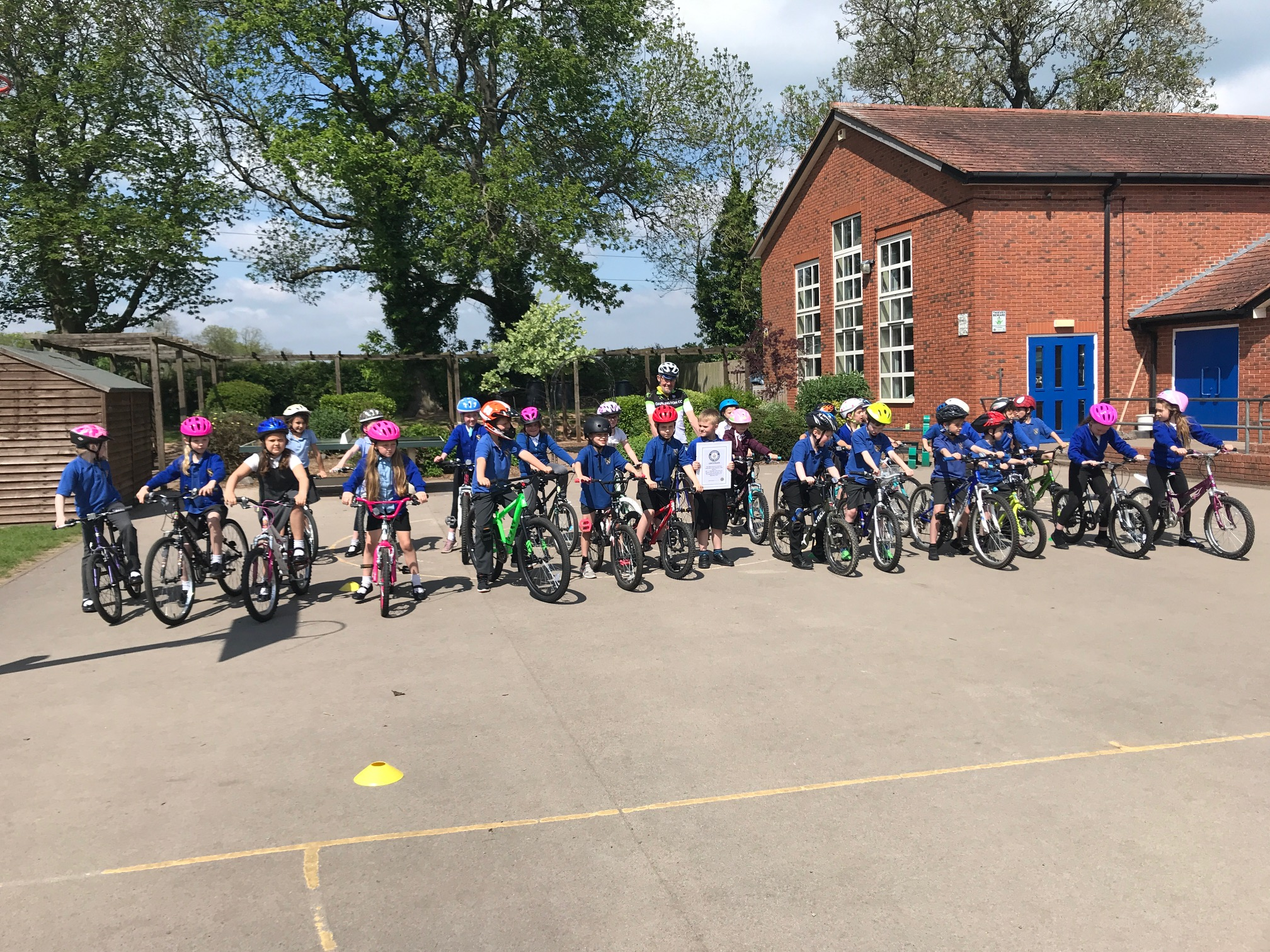 Look at all those bikes, which turned up - there were an equal number cycling in another playground!
