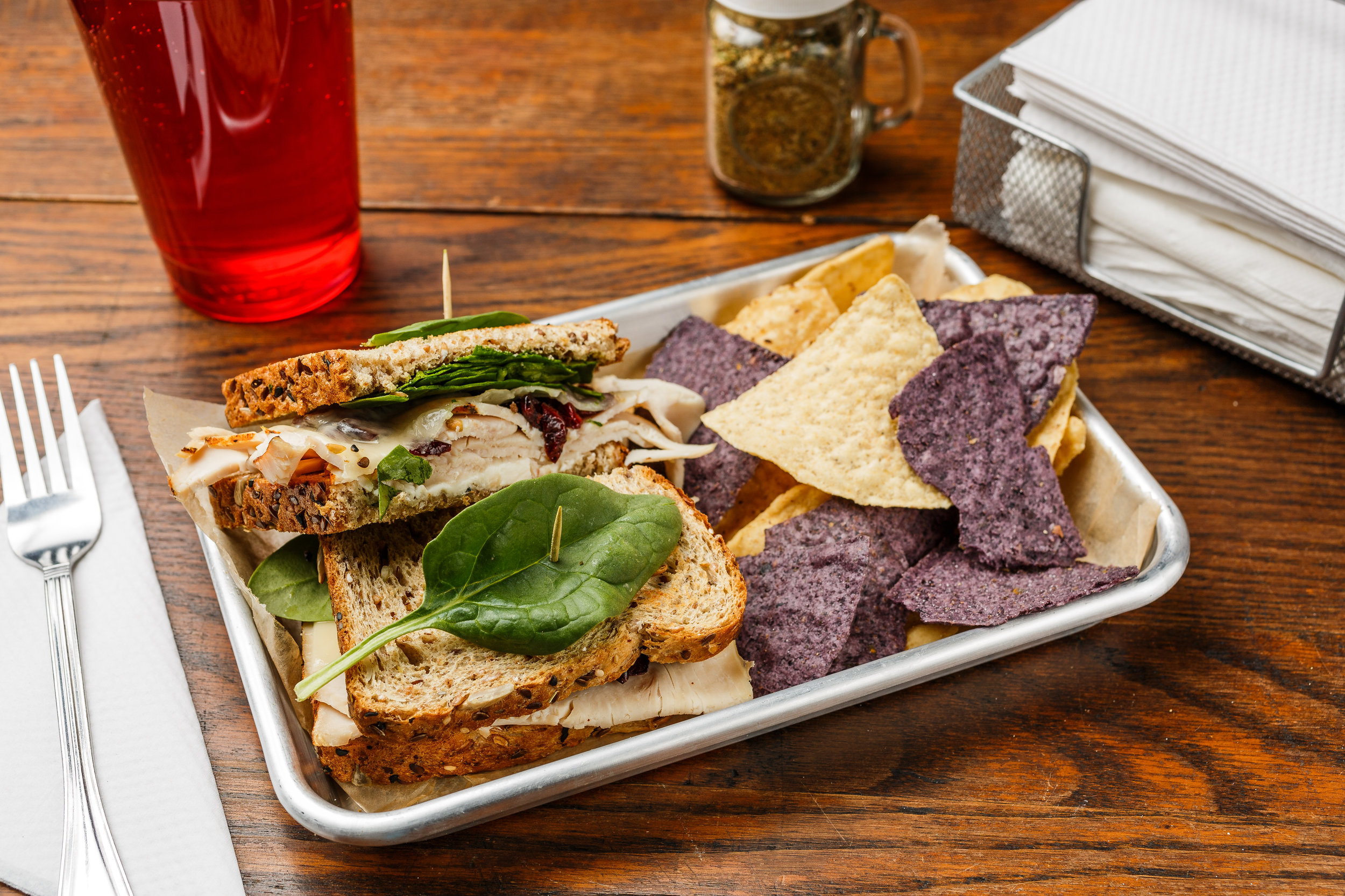 Gobbler  Boar's head turkey, cranberries, Swiss cheese, cream cheese, and spinach. Made as a wrap, sandwich, or salad. Served with organic tortilla chips.   $7.29