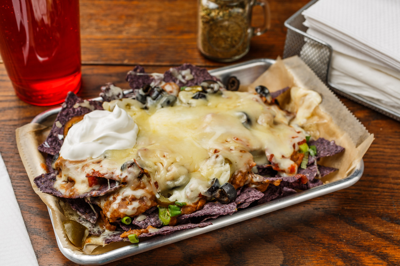 Mega Nachos  Organic blue corn chips, pinto beans, green onions, black olives, jalapeños, sour cream, salsa, and Monterey Jack cheese.  $8.49