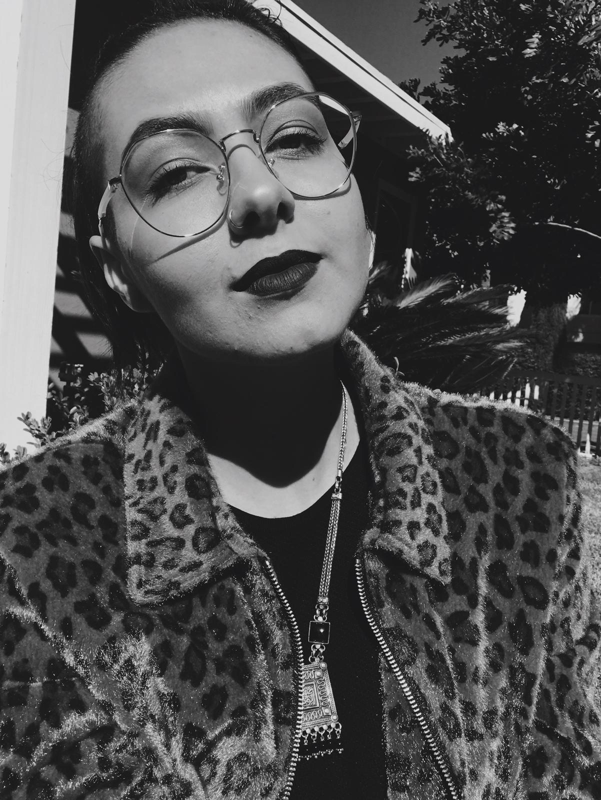 """Layla Zbinden, M.A. (They/Them) - Layla Zbinden (they/them/theirs) is a queer, nonbinary, Arab scholar/activist. They received their BA from UCSD in Psychology with a minor in Critical Gender Studies and went on to receive an M.A. in Women's Studies from San Diego State University. Layla's thesis, """"Path to Self, Path to Home: Arab Diasporic Reflections on State Violence, Authenticity, and Belonging"""" used autoethnography/ethnographic research methods and decolonial feminist methodologies as a ways to explore the multiple ways queer Arab Muslim bodies experience surveillance and cultural authenticity. Between the interpersonal/familial surveillance manifested in Arab-Muslim households and the structural surveillance enacted against bodies racialized in a post-9/11 context, they explored how the state weaponizes those forms of control and actualize a fullest self.Layla will start their PhD in American Studies and Ethnicities at the University of Southern California inshallah August 2019, where they will continue to explore the various ways that technologies of state surveillance ultimately seeks to control communities of color, and what this means for the futures of activism and liberatory potentials of technologies of the state. Their desire to crip and queer the very technologies that surveil, murder, and disappear Arabs, Muslims, Black, Indigenous and other communities' stems from a deep investment in decolonial feminist, queer of color, and disability studies frameworks. Methodologies – the frameworks of how and why we create the knowledge that we do, of which knowledges we uphold and why–is an integral component to Layla's academic writing and the work they do. They seek to push past conventional understandings of what can and cannot count as academic writing, often integrating raw prose and tapping into visceral affective responses as modes of learning, and unlearning. Layla's work, their pedagogy and the essence of their projects (academicpersonalpolitical, as t"""