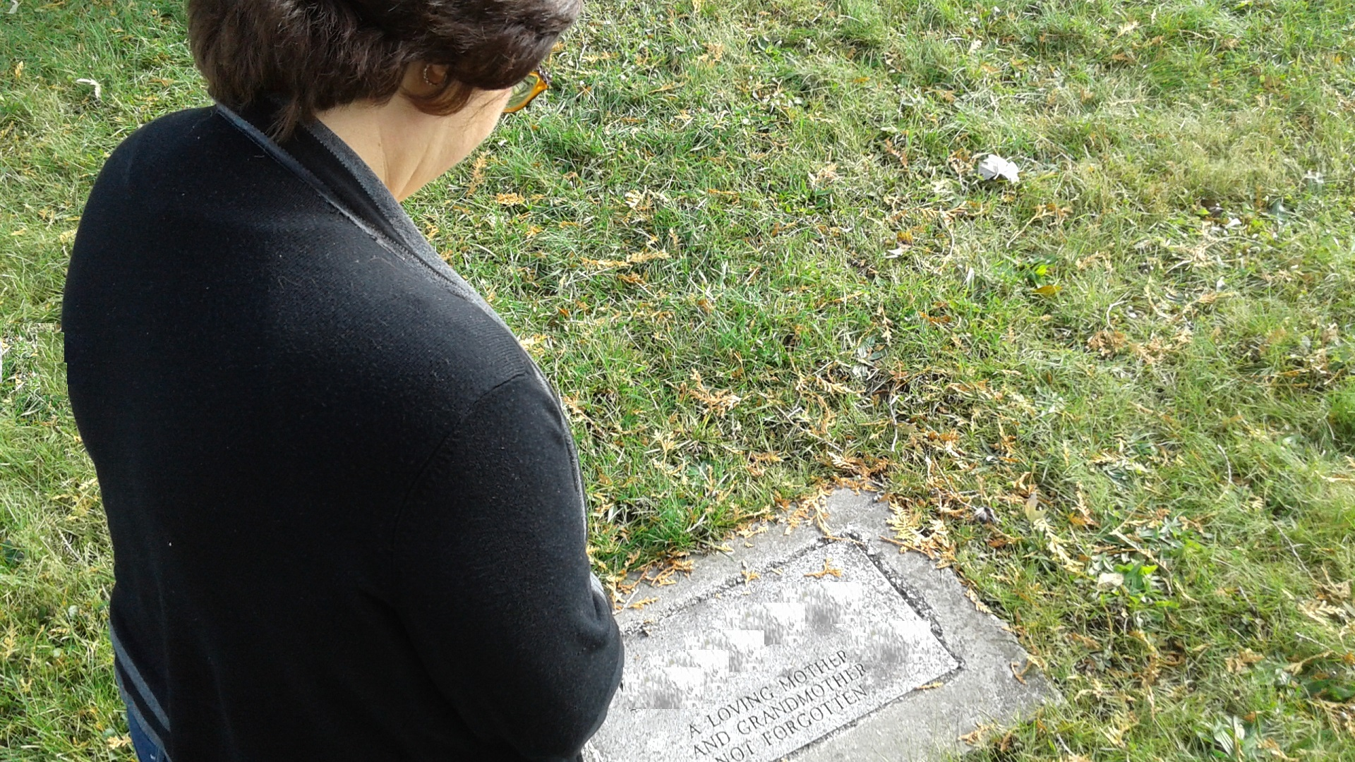 Paying respects to her birth mother, Beth Steury has many questions, yet is at peace with the information she has uncovered with DNA tests and genealogical research. Photo courtesy of Beth Steury.