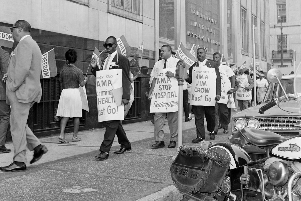 Protesters marching against hospital segregation and health care inequality in front of the American Medical Association's Chicago headquarters in 1963. Bettmann, via Getty Images