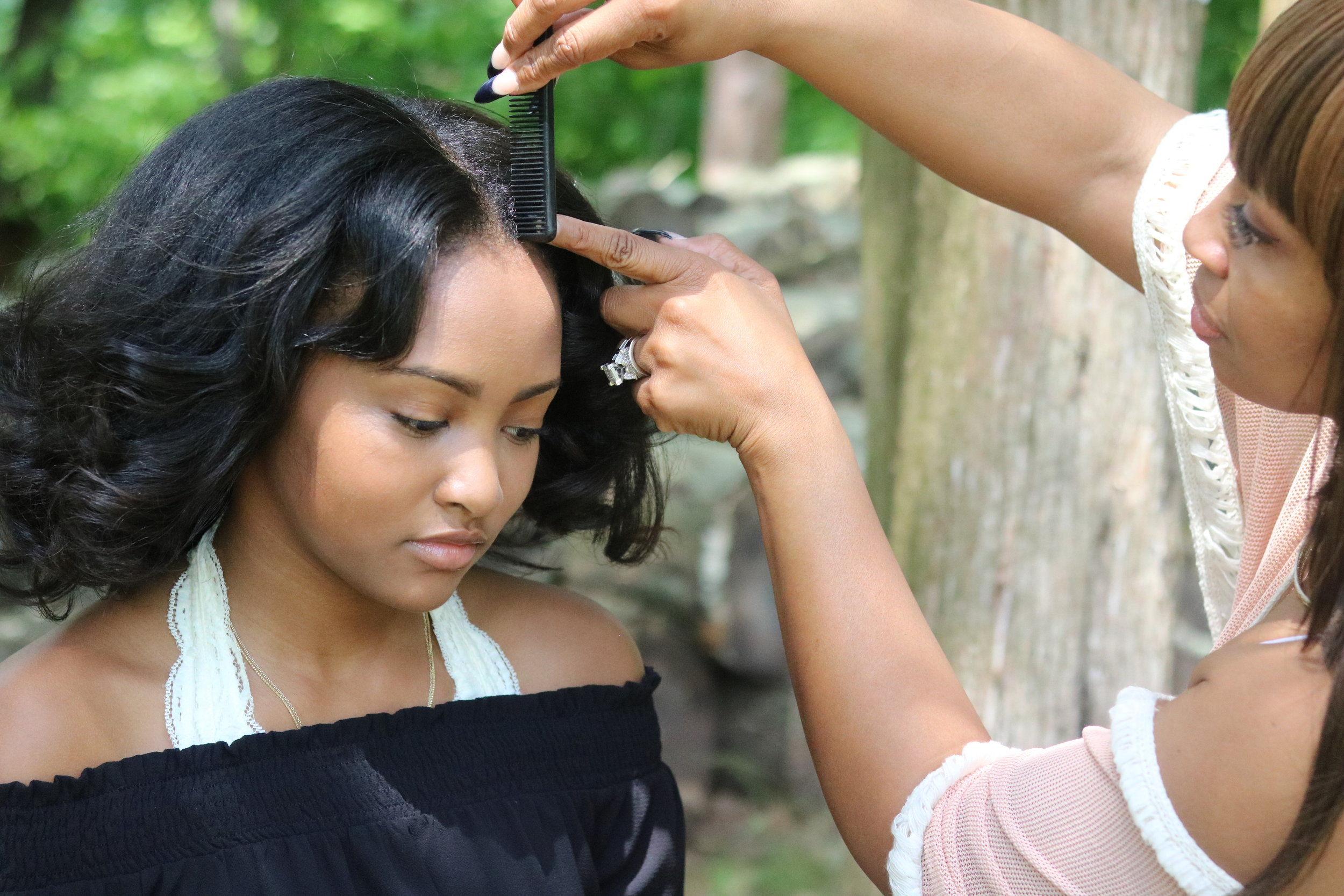 Theresa makes it a priority to teach her clients & her daughter healthy hair practices