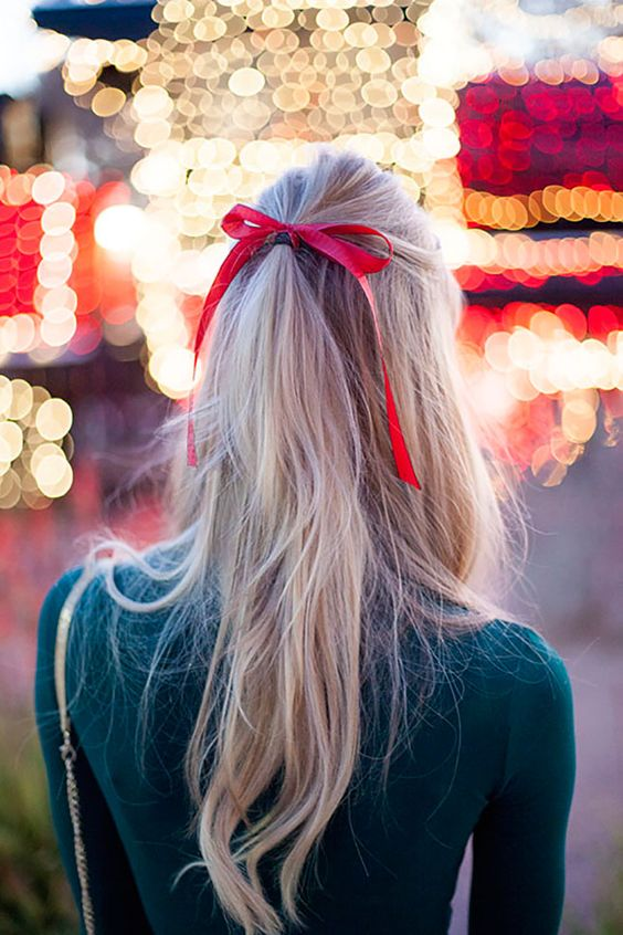 bows - Festive, feminine, and easy to do at home, adding a bow of festive color to any look, such as a half up/half down style, or a top knot, intensifies the holiday aspect of the hairstyle.