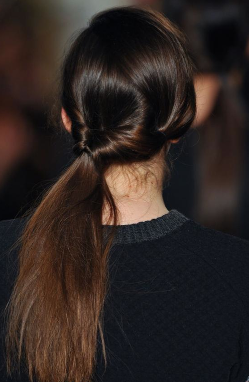 2. Looped Ponytail - Perfectly knot your low pony to create a trendy, romantic look.