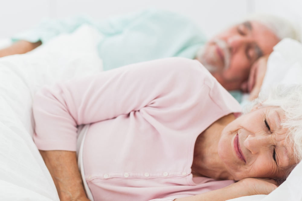 elderly_couple_sleeping_bed.jpg
