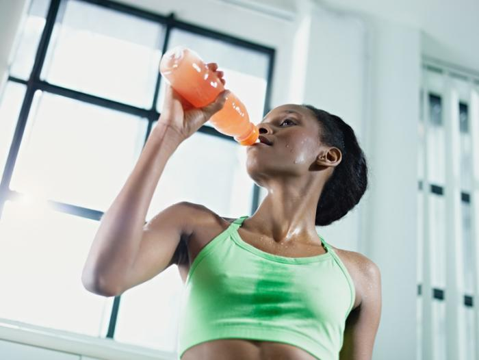 woman-exercising-and-drinking-a-sports-drink.jpg