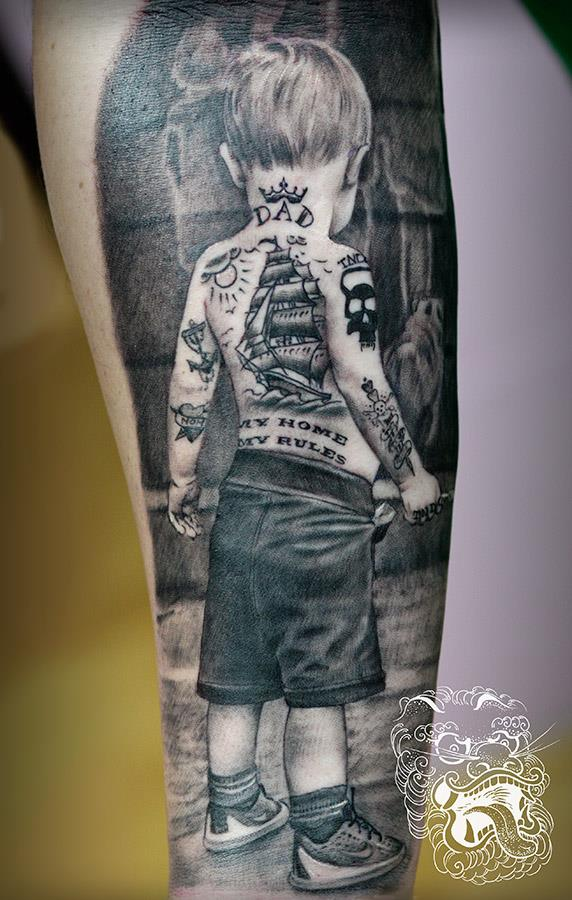 Father and son tattoo I did. Picture of a boy was taken be me. We let him run around and I took few shots. Then, I added fake tattoos to his skin. One of them is Dad tattoo, second is my clients company logo. Even background holds some family tattoo symbolism.