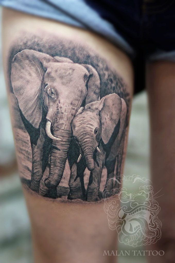 In this animal tattoo elephants were executed in black and grey to stress romantic picture of mother caring for her child.