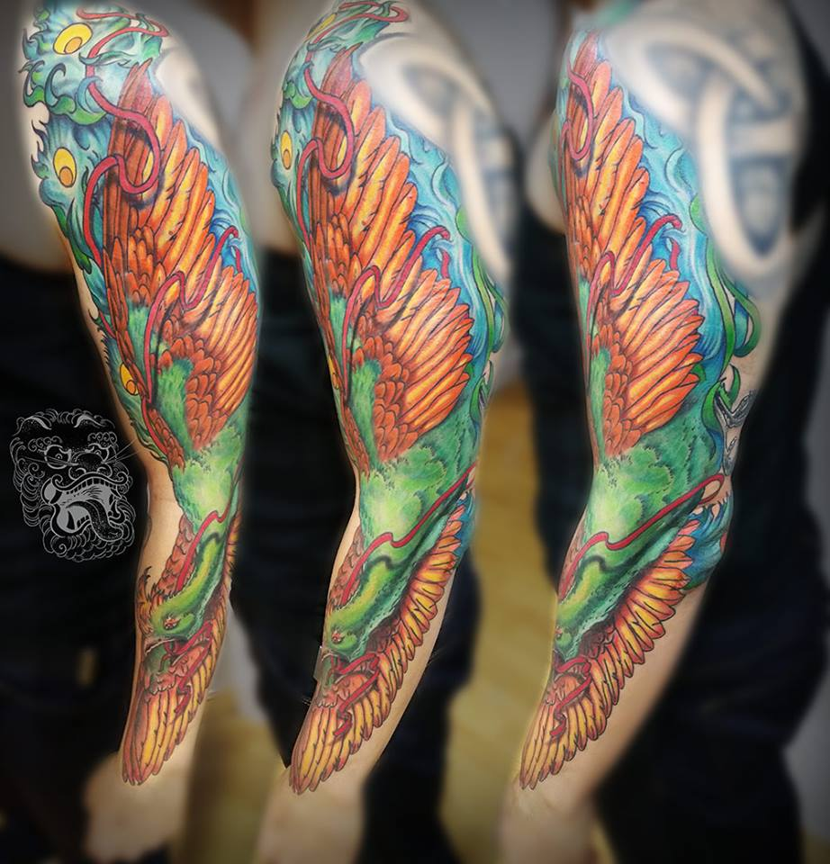 The idea behind this full color phoenix tattoo was to create an effect of the big wing along with Phoenix image. That way what viewer sees first is a big shape, and then when he approaches closer - the detail is visible.