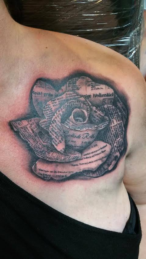 Rose tattoo here was made of newspaper from the day family relative passed away.