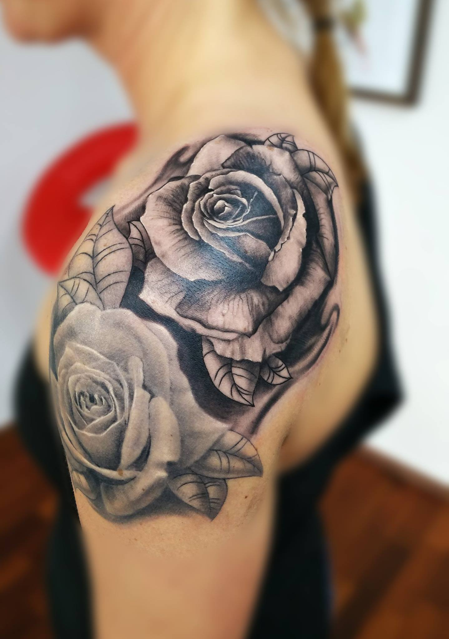 Rose tattoos with a bit transition between traditional and realism.
