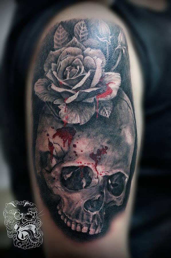 Skulls and roses tattoo.