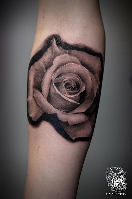Realistic rose tattoo.