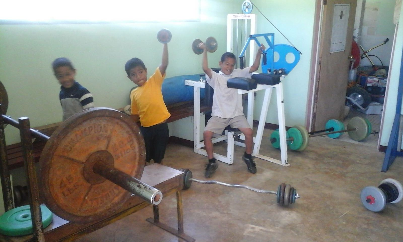 Local Tongan kids testing the gym equipment we sent over in a shipment from Australia