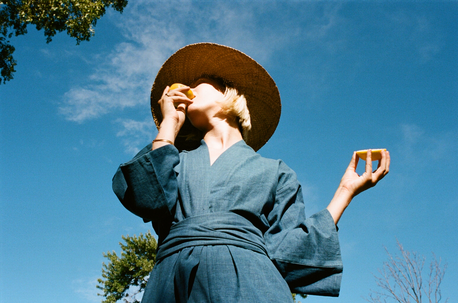 MOMO IS EATING A LEMON, A RISKY BEHAVIOR WHILE WEARING AN INDIGO ROBE...