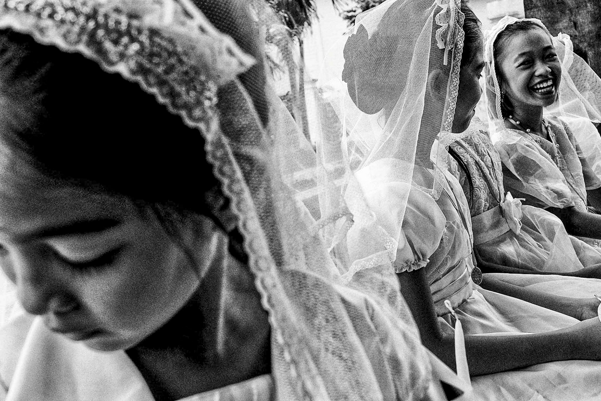 Catholic school girls await their first communion rights months after Typhoon Haiyan, the strongest typhoon ever recorded, wreaked havoc in the greater region of the central Philippines. © Veejay Villafranca