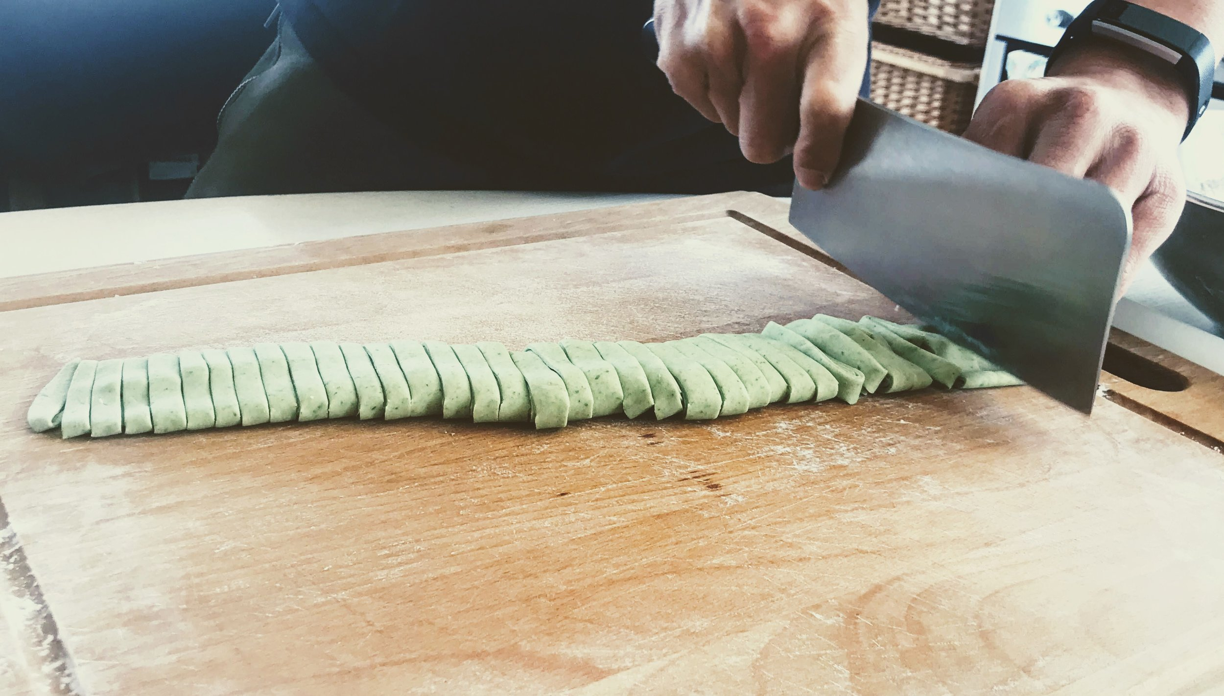 Home Made spinach Noodles - Shifu cutting up the Spinach Dough