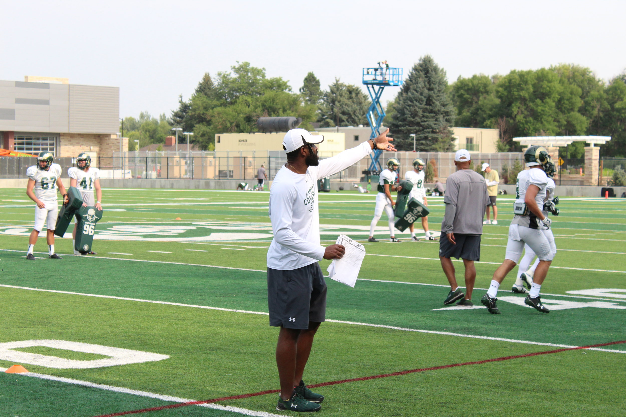 Trent Matthews gives out instructions during a preseason practice in 2018.