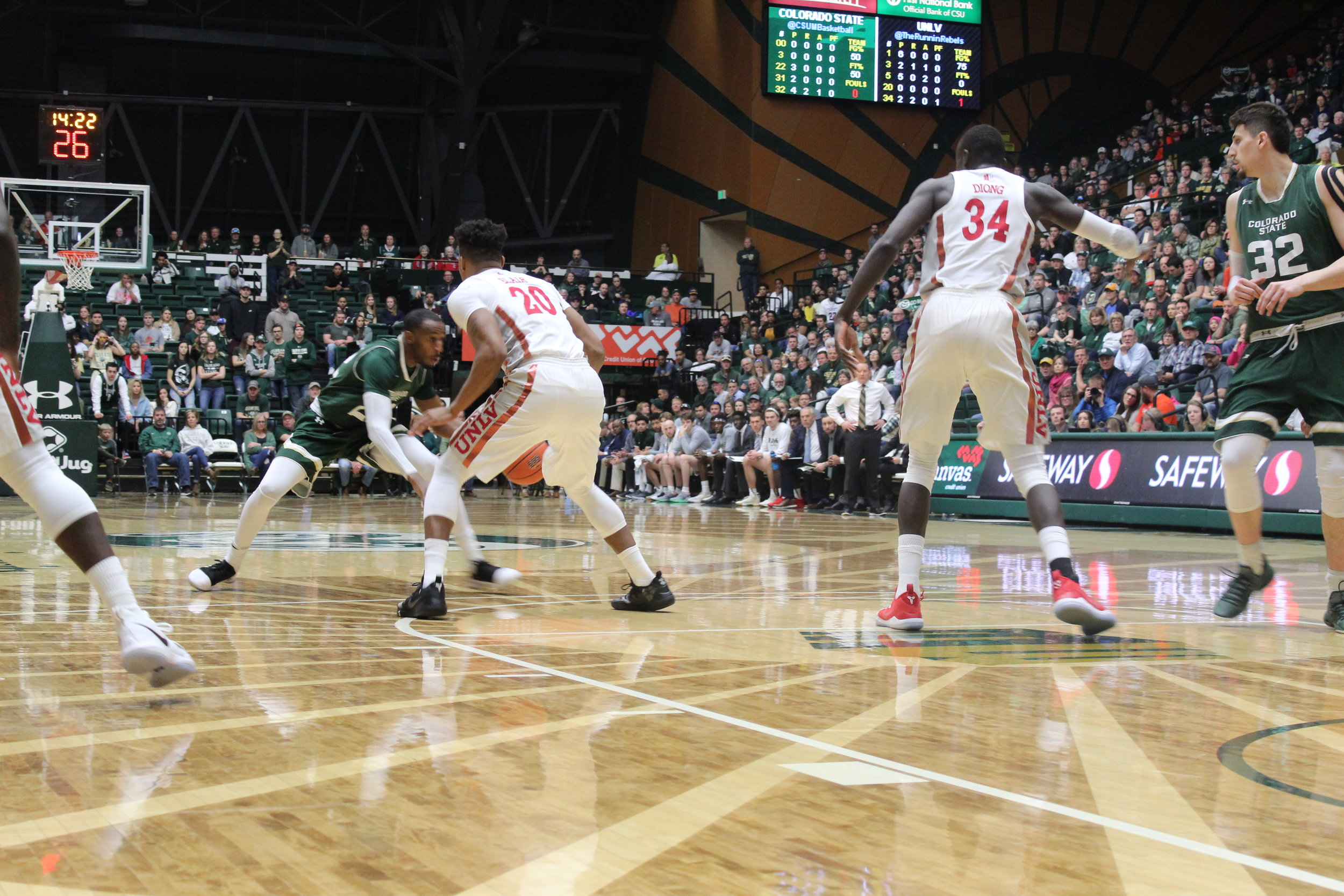 J.D. Paige crosses up a UNLV defender in the lane.