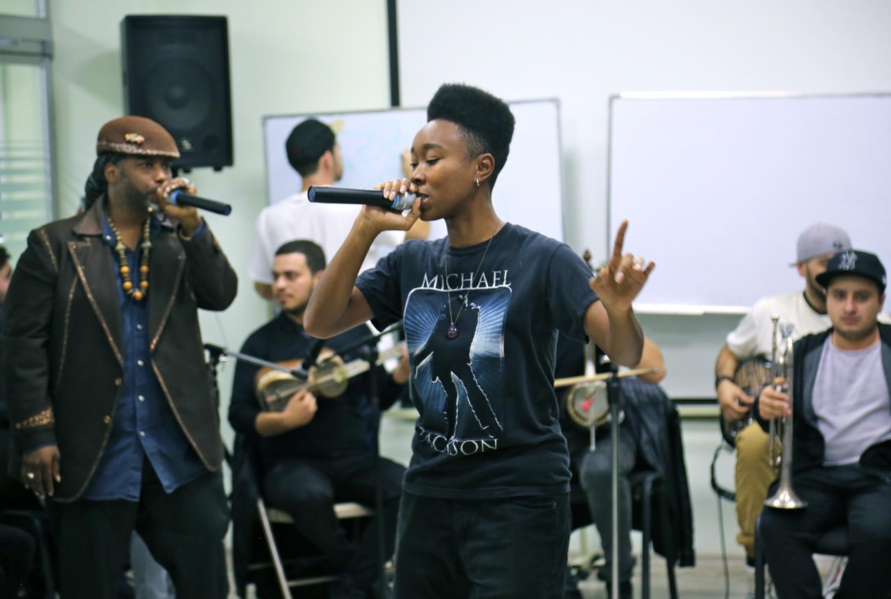 team performaing at the Baku American center.jpg