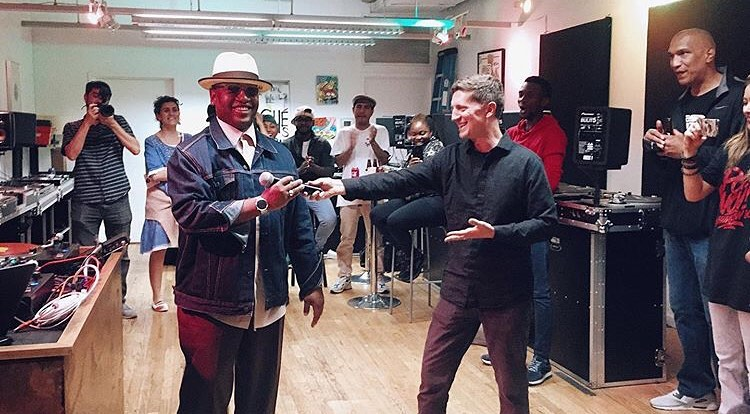 Mark Katz officially passes the mic to Junious Brickhouse at the Next Level Global Mixer and Jam (Photo by Adum7)