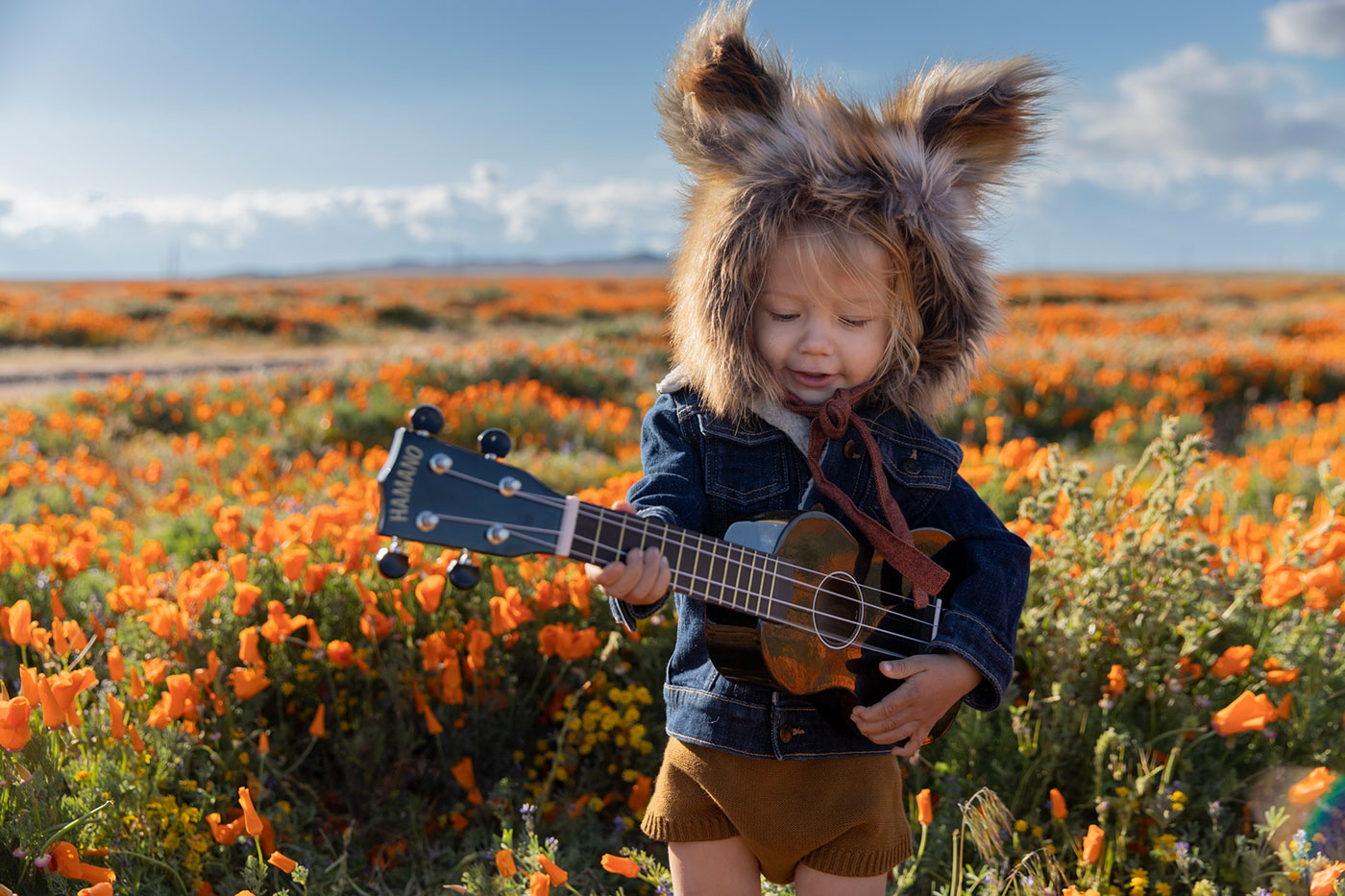 mateo-playing-guitar-in-flowers.jpg