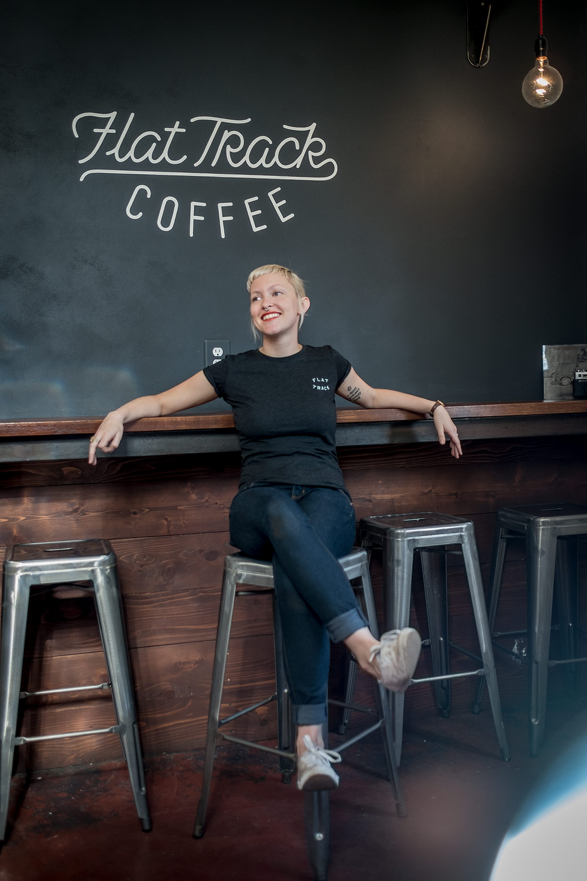 Woman laughing in coffee shop