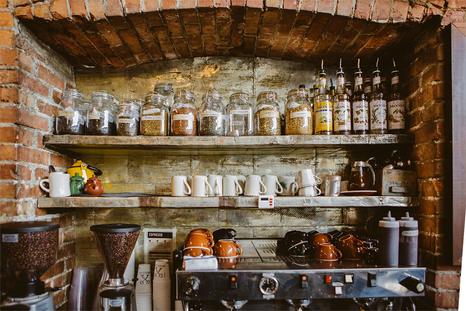 Shelves of spices and coffee in old building