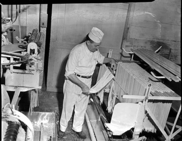MOHAI - Man hanging noodles on drying   rack at Mission   Macaroni   Co. ,  Seattle ,  January   1952