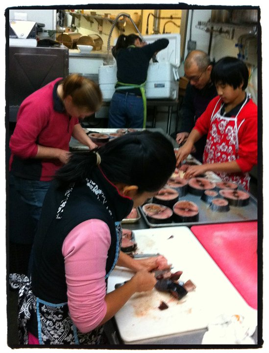 June Lee (bottom left), Philip Lee (top right), Amy Grondin (top center) skinning and cleaning albacore.